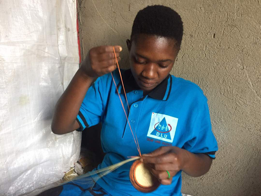 Deaf-girl-in-Fort-Portal-with-delicat-crafts-2
